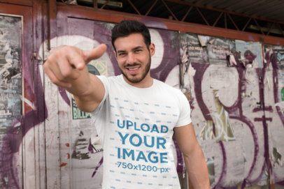 T-Shirt Mockup of a Fitness Man Pointing at the Camera 28527