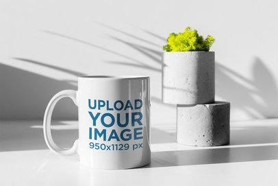 Mockup of an 11 oz Mug with a Plant Pot Under Lights and Shadows 399-el