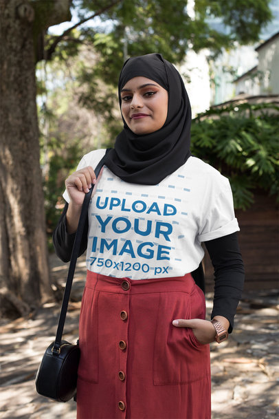 T-Shirt Mockup of a Smiling Woman in a Hijab at a Park 28408