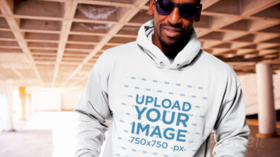 Pullover Hoodie Video Featuring a Smiling Man with Sunglasses at an Empty Parking Lot 13124