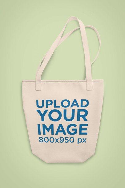 Customizable Strap Tote Bag Mockup on a Plain Surface 28948