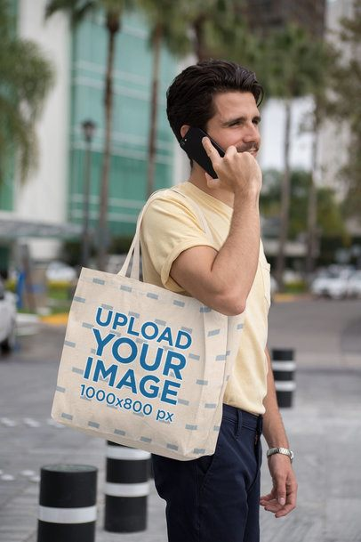 Tote Bag Mockup Featuring a Trendy Man Talking on His Smartphone 28838