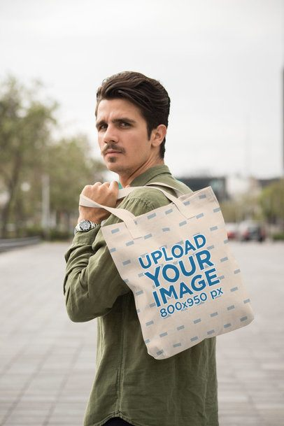 Mockup of a Man with a Mustache Carrying a Tote Bag over His Shoulder 28840