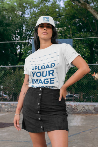 T-Shirt and Dad Hat Mockup of a Woman Posing with Trees in the Background 28596