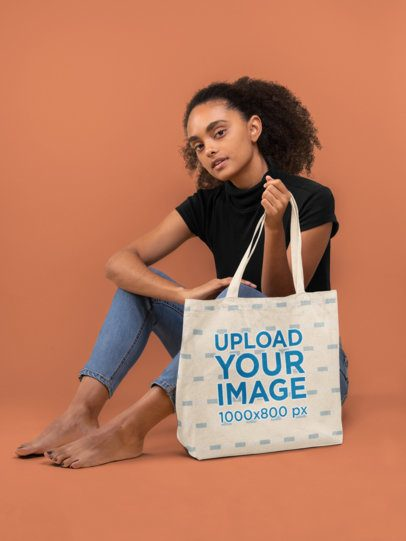 Tote Bag Mockup of a Young Woman Sitting Barefoot 28865