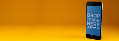 iPhone Mockup Standing Over a Yellow Backdrop a9806