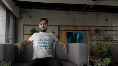 T-Shirt Video of a Man Relaxing on a Gray Couch 28923