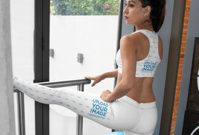 Sports Bra and Leggings Mockup Featuring a Woman Stretching One Leg 28702