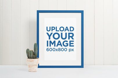 Minimal Mockup Featuring a Picture Frame Standing Next to a Cactus Plant Pot 540-el