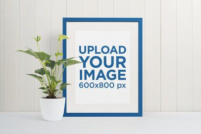 Picture Frame Mockup Featuring a White Wooden Wall and a Plant Pot 542-el