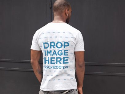 Back Mockup of a Handsome Man Wearing a T-Shirt Facing a Black Door a9365b