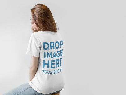 Back of a Redhaired Girl Wearing a T-Shirt Mockup Facing a White Wall a9846b