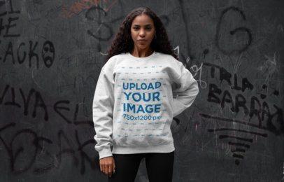 Crewneck Sweatshirt Mockup of a Woman Posing Against a Graffiti Wall 28638