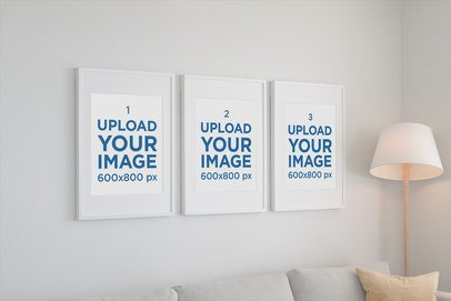 Mockup of Three Poster Frames Hanging on a Living Room Wall 560-el