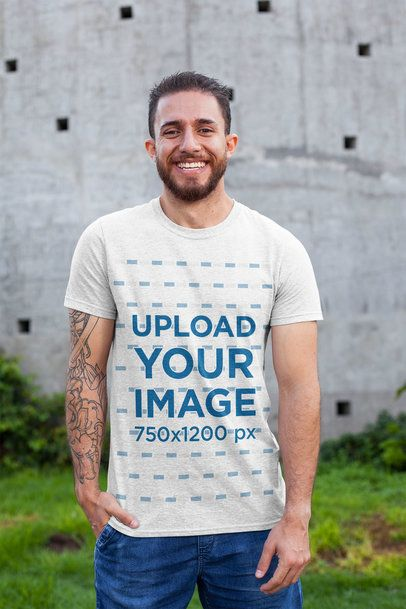 T-Shirt Mockup Featuring a Smiling Man with a Tattooed Arm 28619
