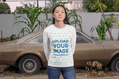 Long Sleeve T-Shirt Mockup Featuring a Woman Standing in Front of a Vintage Car 29068