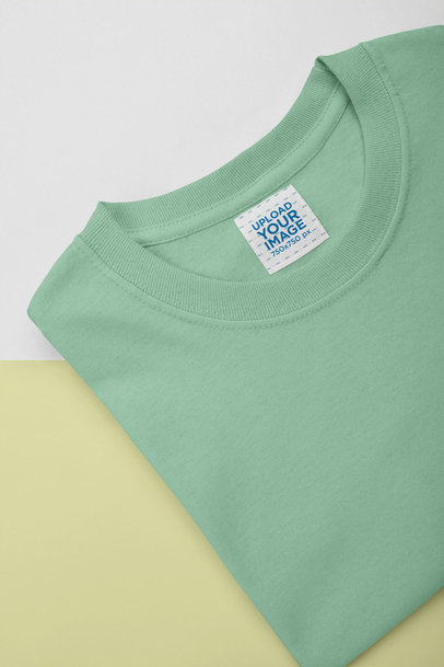 Mockup of an Inside Clothing Label on a Folded Tee 28985