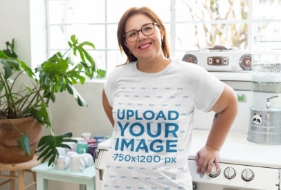 Mockup of a Woman Wearing a Heathered T-Shirt in the Kitchen 28801