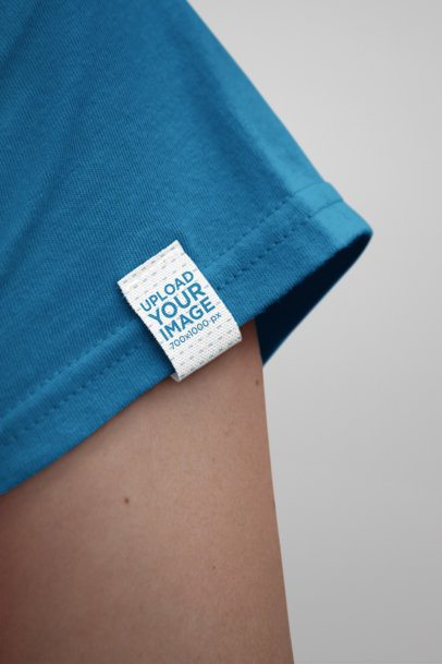 Mockup of a Woman Wearing a Shirt With a Clothing Label Attached to its Sleeve 28992