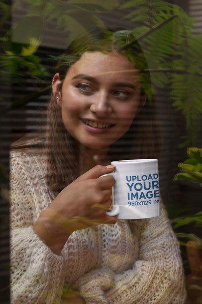 Mockup of a Smiling Woman Holding an 11 oz Coffee Mug 29134