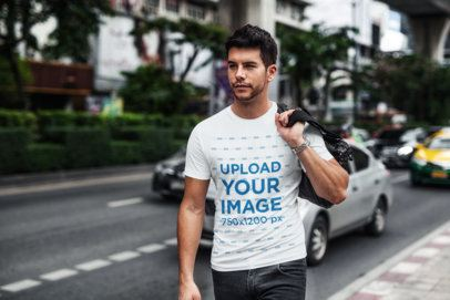 T-Shirt Mockup of a Man Walking by a Busy Street 439-el