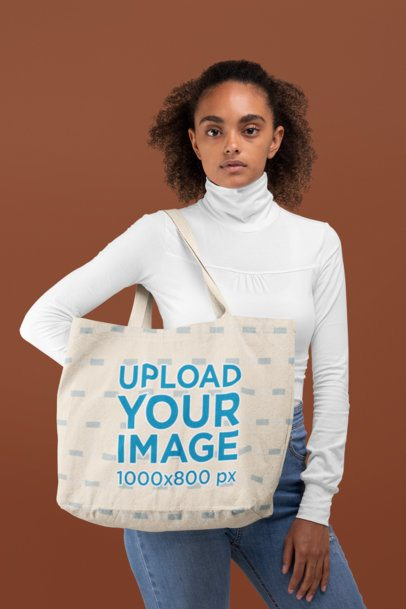 Tote Bag Mockup Featuring a Serious-Looking Woman at a Studio 28870