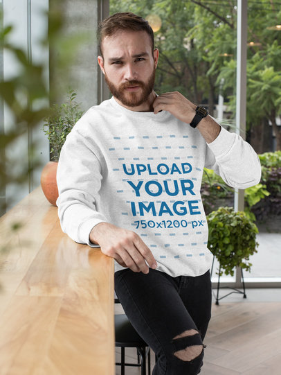 Heather Crewneck Sweatshirt Mockup of a Man Posing by a Wooden Counter 28736