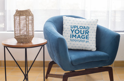 Square Pillow Mockup Featuring a Blue Single Sofa 29011