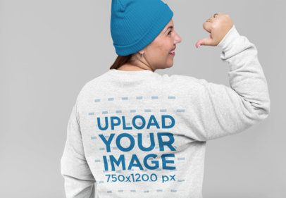 Mockup of a Woman Pointing at the Back of Her Crewneck Sweatshirt 28810
