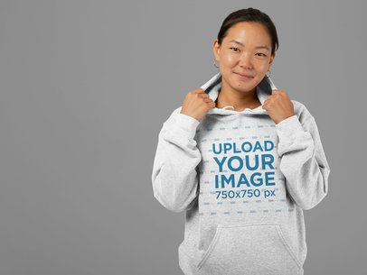 Heathered Pullover Hoodie Mockup Featuring a Woman at a Studio 28755