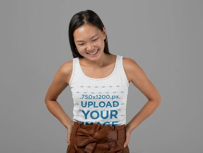 Heathered Tank Top Mockup Featuring a Smiling Woman at a Studio 28757