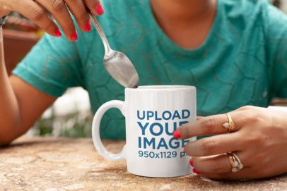 Mockup of a Woman Holding Her 11 oz Coffee Mug at a Restaurant 28941