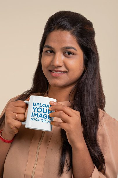 Mockup of a Long-Haired Woman Holding an 11 oz Coffee Mug 29082