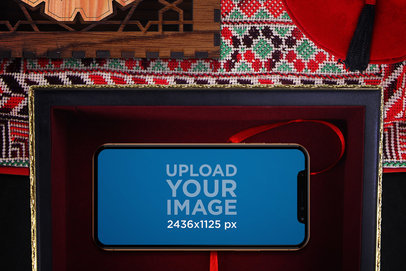 Mockup of an iPhone X in Landscape Position in an Arabic Setting 670-el