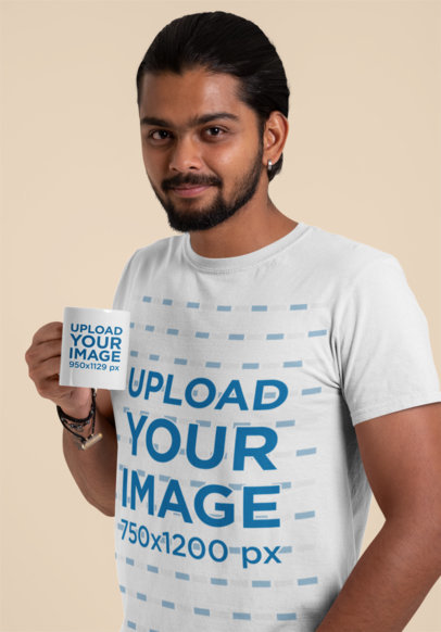 T-Shirt Mockup of a Man Holding an 11 oz Mug in a Studio 29116