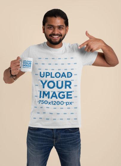T-Shirt Mockup of a Happy Man Pointing at an 11 oz Coffee Mug 29117
