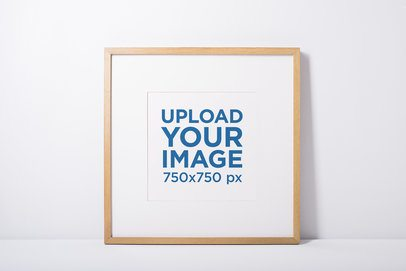 Minimal Mockup Featuring a Photo Frame Against a White Wall 592-el