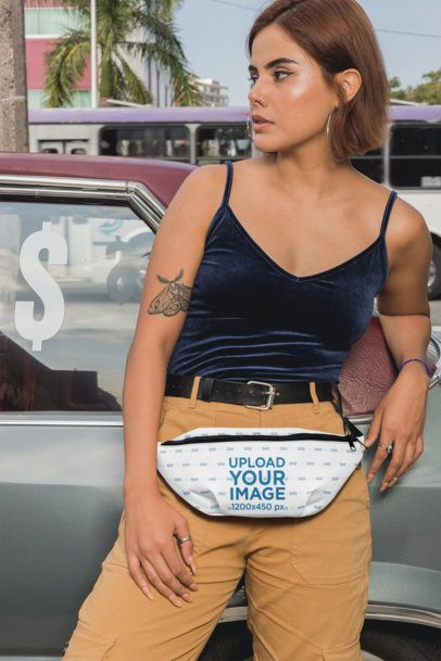 Mockup of a Woman with a Fanny Pack Leaning on an Old Car 29153