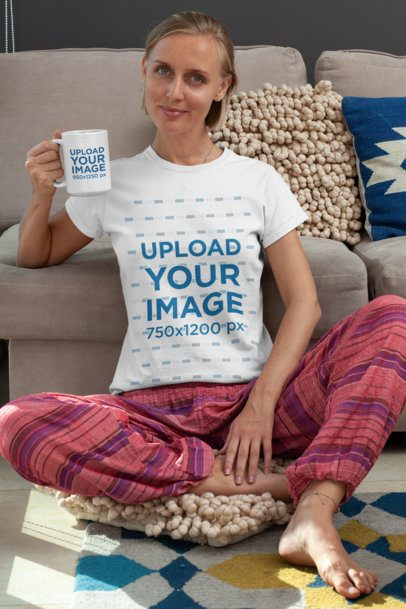 T-Shirt Mockup of a Woman Drinking in Her 15 oz Coffee Mug in Her Living Room 29274