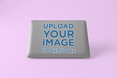 Laptop Sticker Mockup Featuring a Solid Color Background 676-el