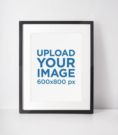 Mockup of a Photo Frame Standing on a White Surface 605-el
