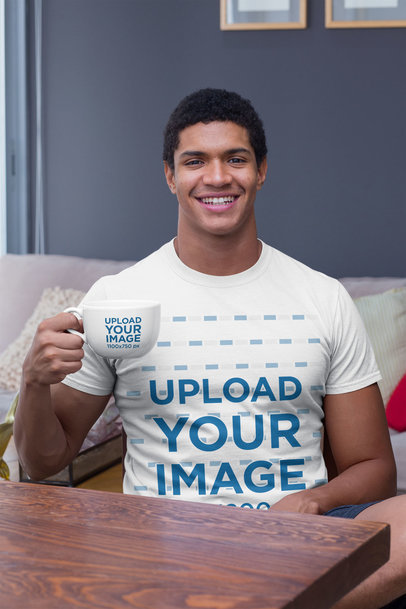 T-Shirt Mockup of a Smiling Man in the Livingroom Holding a 24 oz Coffee Mug 29254