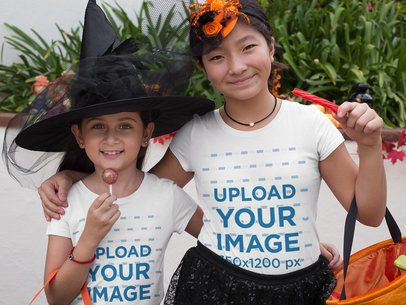 T-Shirt Mockup of Two Girls Trick-or-Treating in Witch Hats 29317