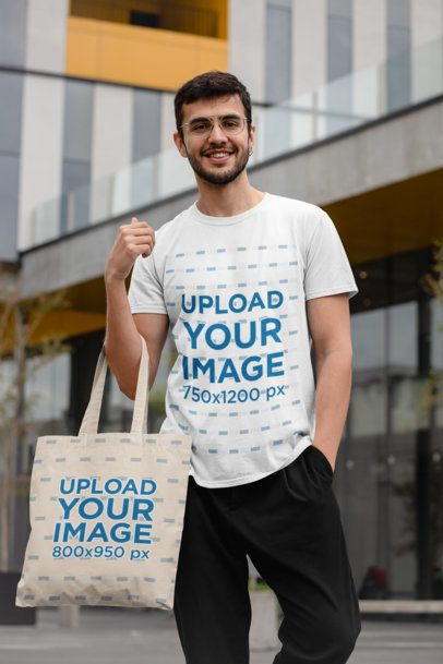 Mockup of a Trendy Man Wearing a T-Shirt and Carrying a Tote Bag 29410