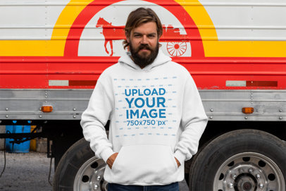 Mockup of Man Wearing a Hoodie Pullover in Front of a Truck 29485