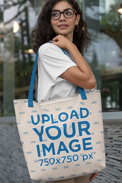 Mockup of a Woman Carrying a Tote Bag with Customizable Strap Over Her Shoulder 29422
