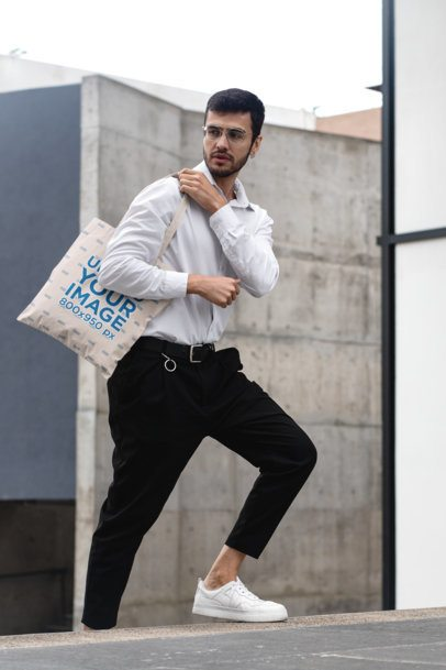 Mockup of a Trendy Man with a Tote Bag in the Street 29429
