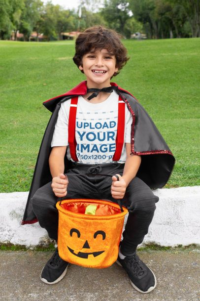 Mockup of a Boy Wearing a T-Shirt and Holding His Pumpkin Basket 29302