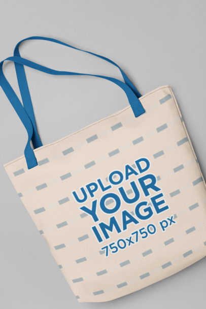 Mockup of a Tote Bag with Customizable Strap Placed over a Flat Surface 29607