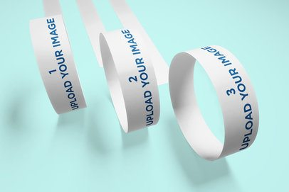 Mockup of Three Paper Wristbands Rolling Towards the Camera 635-el